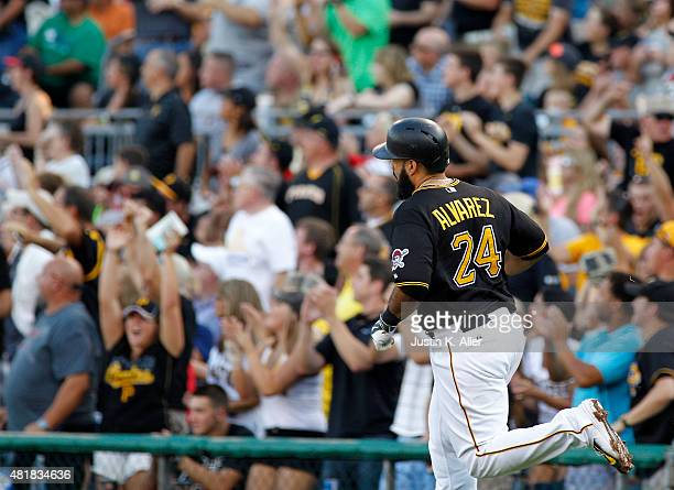 Pedro Alvarez of the Pittsburgh Pirates rounds first after hitting a two run home run in the second inning during the game against the Washington...