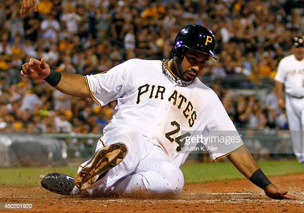Pedro Alvarez of the Pittsburgh Pirates scores on a RBI single in the sixth inning against the Milwaukee Brewers during the game at PNC Park June 6...