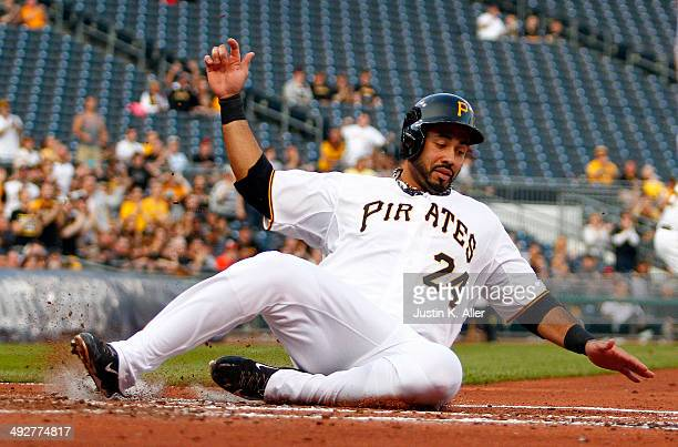 Pedro Alvarez of the Pittsburgh Pirates scores on a twoRBI triple in the first inning against the Baltimore Orioles during interleague play at PNC...