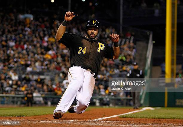 Pedro Alvarez of the Pittsburgh Pirates scores on a wild pitch in the fourth inning against the Toronto Blue Jays during the game at PNC Park May 3...
