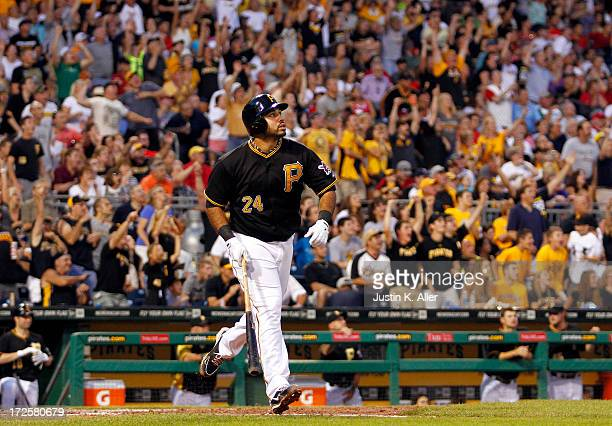 Pedro Alvarez of the Pittsburgh Pirates watches his three run home run in the fifth inning against the Philadelphia Phillies during the game on July...