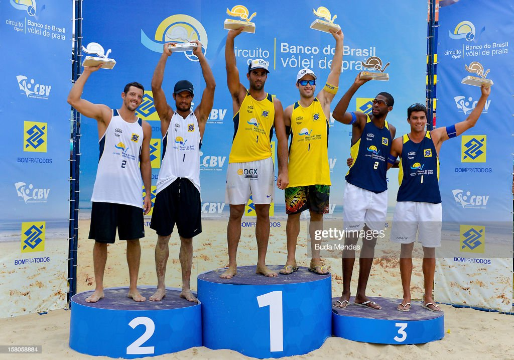 Pedro and Bruno (first place), Oscar and Moises (second place) and Everton and Vitor (third place) pose for a picture at the podium after the 6th round of the Banco do Brasil Beach Volleyball Circuit at Copacabana Beach on December 09, 2012 in Rio de Janeiro, Brazil.