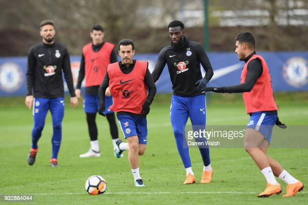 Pedro and Tiemoue Bakayoko of Chelsea during a training session at Chelsea Training Ground on March 16 2018 in Cobham United Kingdom
