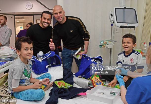 Pedro and Willy Caballero of Chelsea at the Chelsea and Westminster Christmas Hospital visit on December 7 2017 in London England