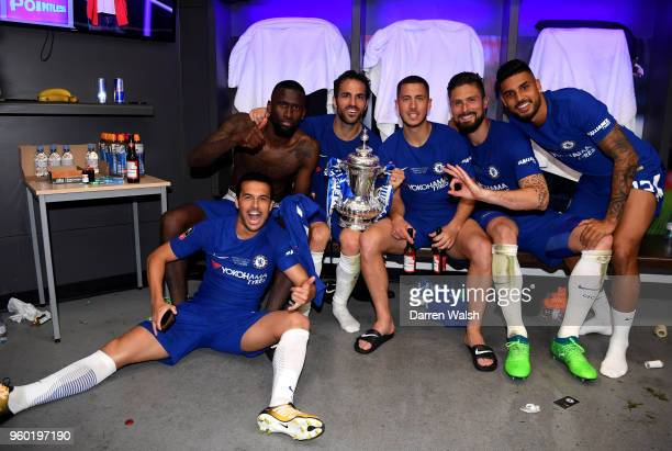 Pedro Antonio Rudiger Cesc Fabregas Eden Hazard Olivier Giroud and Emerson Palmieri of Chelsea pose with the Emirates FA Cup trophy in the changing...