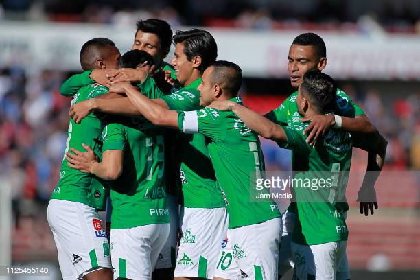 Pedro Aquino of Leon celebrates with teammates after scoring the first goal for his team during the 4th round match between Queretaro and Leon as...