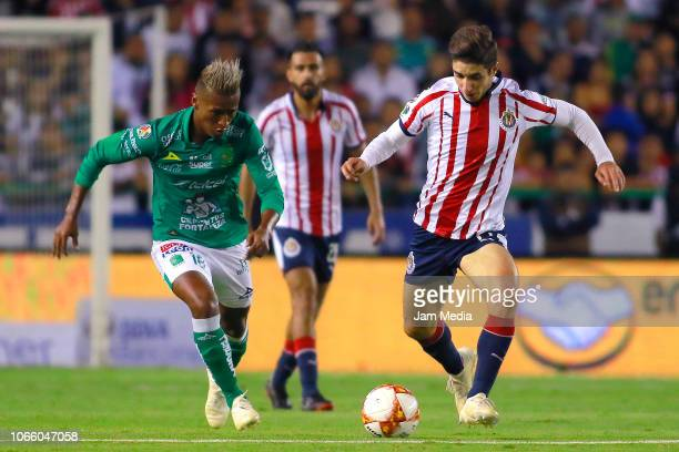 Pedro Aquino of Leon fights for the ball with Isaac Brizuela of Chivas during a 16th round match between Leon and Chivas as part of Torneo Apertura...