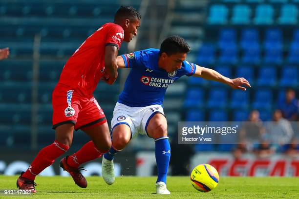 Pedro Aquino of Lobos BUAP struggles for the ball with Angel Mena of Cruz Azul during the 14th round match between Cruz Azul and Lobos BUAP at Azul...