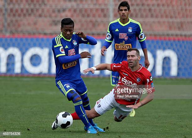 Pedro Aquino of Sporting Cristal struggles for the ball with Hector Icart of Cienciano during a match between Cienciano and Sporting Cristal as part...