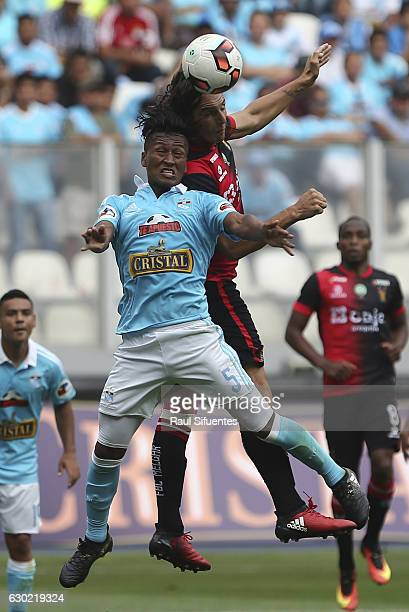 Pedro Aquino of Sporting Cristal struggles for the ball with Jose Fernandez of FBC Melgar during a second leg final match between Sporting Cristal...