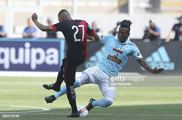 Pedro Aquino of Sporting Cristal struggles for the ball with Patricio Arce of FBC Melgar during a second leg final match between Sporting Cristal and...