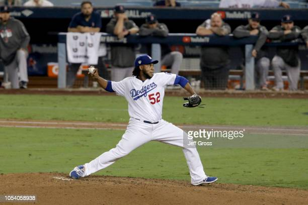 Pedro Baez of the Los Angeles Dodgers delivers the pitch against the Boston Red Sox during the tenth inning in Game Three of the 2018 World Series at...