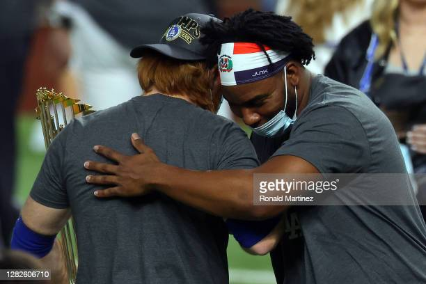 Pedro Baez of the Los Angeles Dodgers embraces Justin Turner after the teams 31 victory against the Tampa Bay Rays in Game Six to win the 2020 MLB...