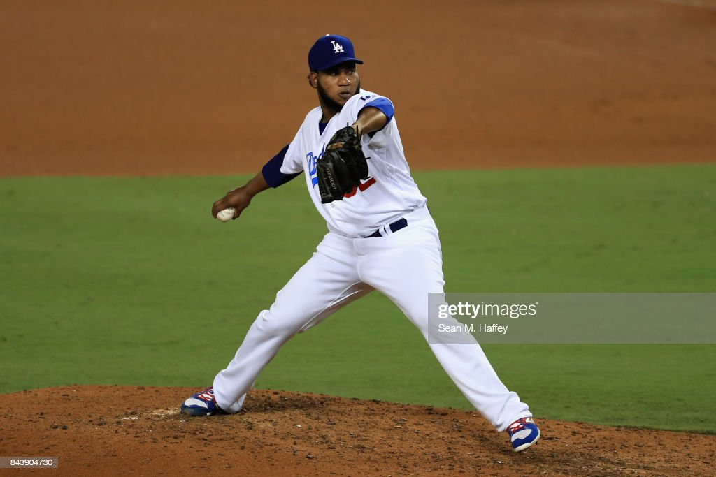 Pedro Baez #52 of the Los Angeles Dodgers pitches during a game against the Arizona Diamondbacks at Dodger Stadium on September 5, 2017 in Los Angeles, California.