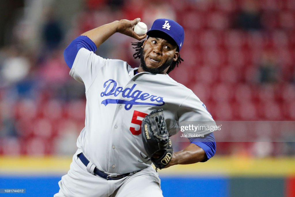 Pedro Baez #52 of the Los Angeles Dodgers pitches in the seventh inning of the game against the Cincinnati Reds at Great American Ball Park on September 11, 2018 in Cincinnati, Ohio. The Reds won 3-1.
