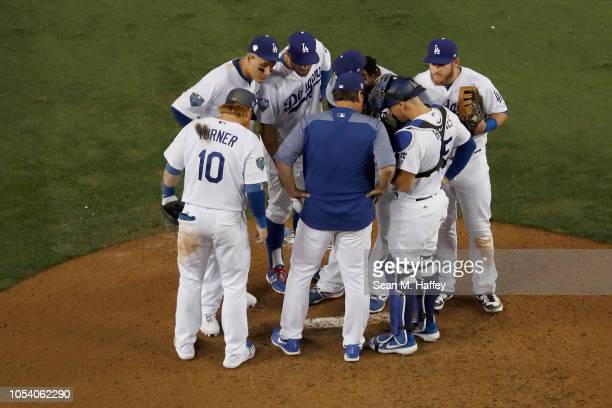 Pedro Baez of the Los Angeles Dodgers receives a mount visit against the Boston Red Sox during the tenth inning in Game Three of the 2018 World...