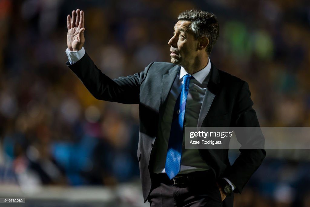 Pedro Caixinha, coach of Cruz Azul, gets out of the field after being expeled during the 15th round match between Tigres UANL and Cruz Azul as part of the Torneo Clausura 2018 Liga MX at Universitario Stadium on April 14, 2018 in Monterrey, Mexico.