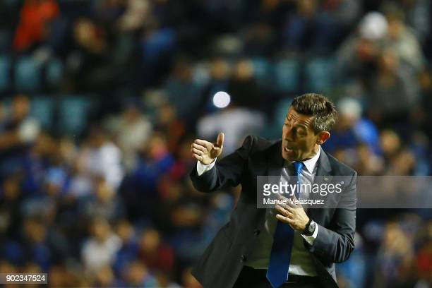 Pedro Caixinha coach of Cruz Azul gives instructions to his players during the first round match between Cruz Azul and Tijuana as part of the Torneo...