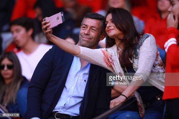 Pedro Caixinha coach of Cruz Azul takes a selfie with a fan during the first round match between Toluca and Chivas as part of the Torneo Clausura...