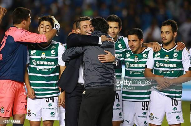 Pedro Caixinha coach of Santos Laguna celebrates with Alejandro Irarragorri President of Santos after a championship second leg match between...