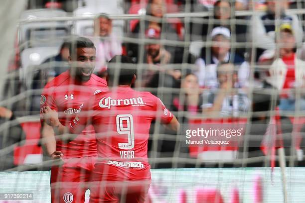 Pedro Canelo of Toluca celebrates with teammate Ernesto Vega after scoring the first goal of his team during the 6th round match between Toluca and...