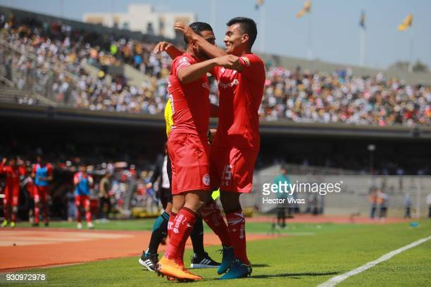 Pedro Canelo of Toluca celebrates with teammates after Marcelo Diaz of Pumas scored an own goal during the 11th round match between Pumas UNAM and...