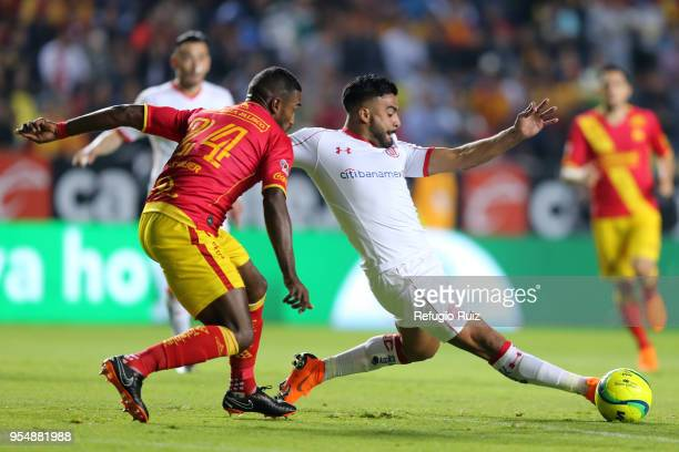 Pedro Canelo of Toluca fights for the ball with Gabriel Achilier of Morelia during the quarter finals first leg match between Morelia and Toluca as...