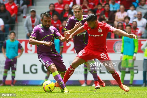 Pedro Canelo of Toluca fights for the ball with Osmar Mares of Veracruz during the 16th round match between Toluca and Veracruz as part of the Torneo...