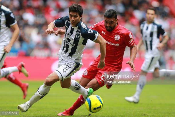 Pedro Canelo of Toluca struggles for the ball against Stefan Medina of Monterrey during the 6th round match between Toluca and Monterrey as part of...