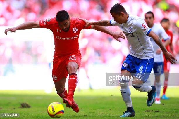 Pedro Canelo of Toluca struggles for the ball with Julio Cesar Dominguez of Cruz Azul during the 4th round match between Toluca and Cruz Azul as part...