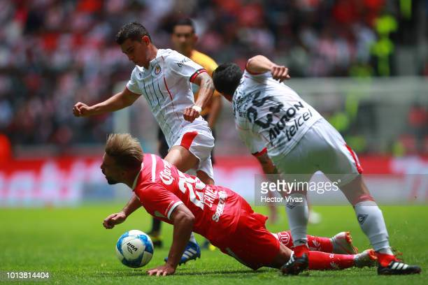 Pedro Canelo of Toluca struggles for the ball with Michael Perez of Chivas during the third round match between Toluca and Chivas as part of the...