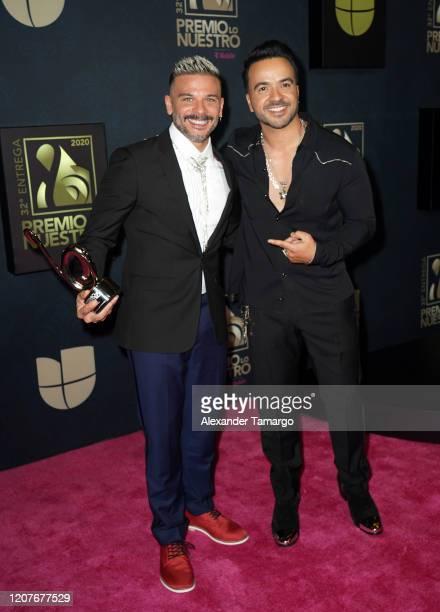 Pedro Capo and Luis Fonsi pose backstage during Univision's Premio Lo Nuestro 2020 at AmericanAirlines Arena on February 20 2020 in Miami Florida