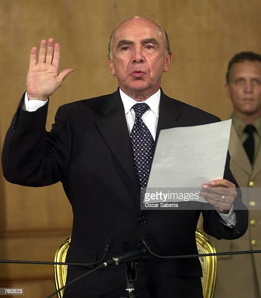 Pedro Carmona takes the oath as he is sworn in as Venezuela's interim president April 12 2002 at Miraflores presidential palace in Caracas Venezuela...