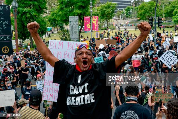 Pedro Chavez shouts toward police officers during a demonstration over the death of George Floyd while in Minneapolis Police custody in downtown Los...