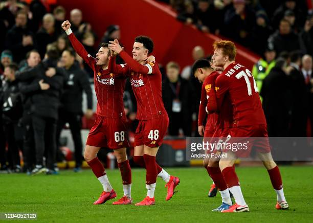 Pedro Chirivella and Curtis Jones of Liverpool celebrating at the end of the FA Cup Fourth Round Replay match between Liverpool FC and Shrewsbury...