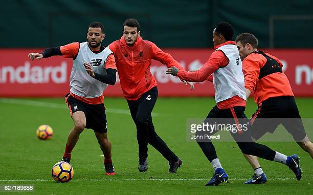 Pedro Chirivella and Kevin Stewart of Liverpool during a training session at Melwood Training Ground on December 2, 2016 in Liverpool, England.