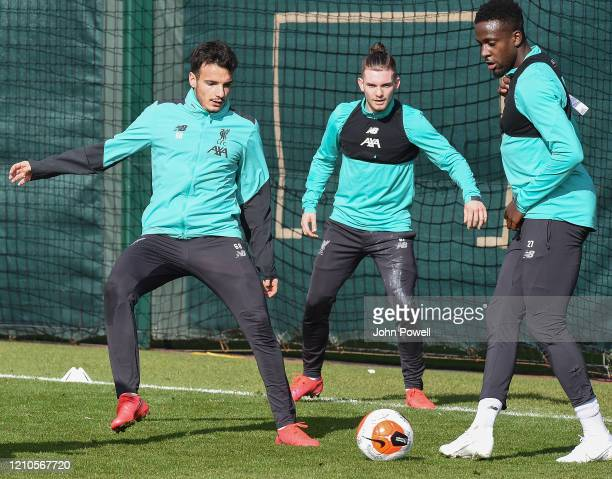 Pedro Chirivella, Harvey Elliott and Divock Origi of Liverpool during a training session at Melwood Training Ground on March 05, 2020 in Liverpool,...