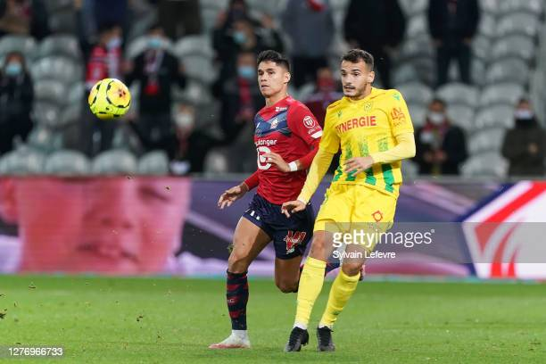 Pedro Chirivella of FC Nantes compete for the ball with Luiz Araujo of Lille OSC during the Ligue 1 match between Lille OSC and FC Nantes at Stade...