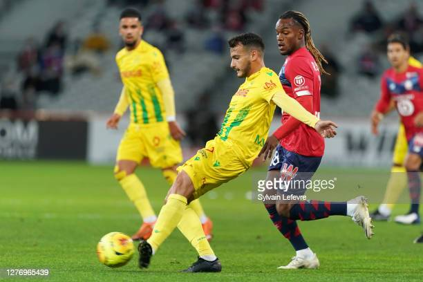 Pedro Chirivella of FC Nantes compete for the ball with Renato Sanches of Lille OSC during the Ligue 1 match between Lille OSC and FC Nantes at Stade...