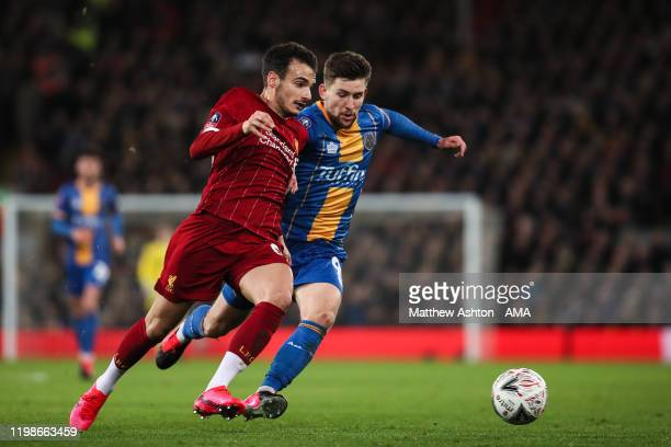 Pedro Chirivella of Liverpool and Callum Lang of Shrewsbury Town during the FA Cup Fourth Round Replay match between Liverpool and Shrewsbury at...