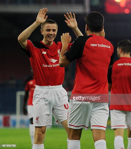 Pedro Chirivella of Liverpool celebrates after scoring with Jordan Rossiter during a training session on July 23 2015 in Kuala Lumpur Malaysia