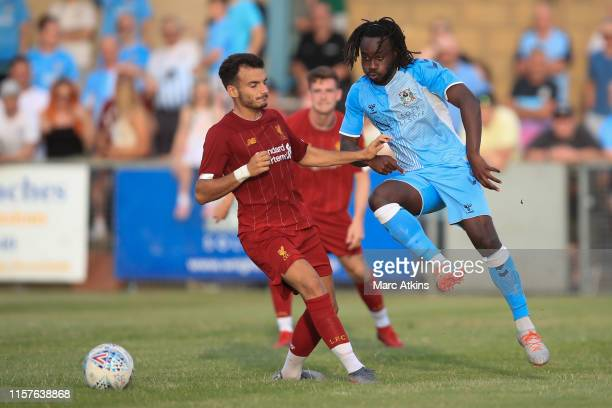 Pedro Chirivella of Liverpool in action with Fankaty Dabo of Coventry City during the PreSeason Friendly match between Coventry City and Liverpool...