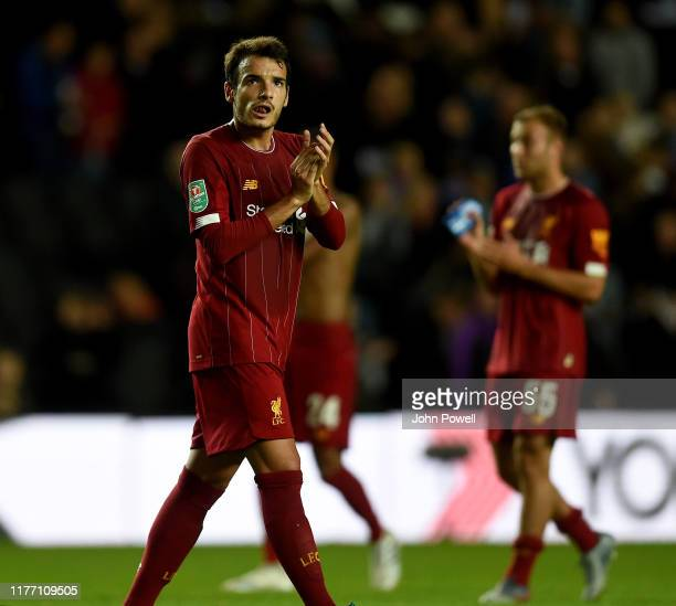 Pedro Chirivella of Liverpool showing his appreciation to the fans at the end of the Carabao Cup Third Round match between Milton Keynes Dons and...