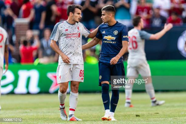 Pedro Chirivella of Liverpool talks with Andreas Pereira of Manchester United after the International Champions Cup 2018 at Michigan Stadium on July...