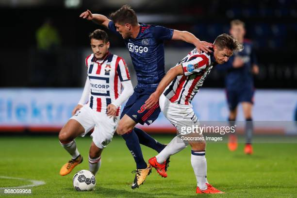 Pedro Chirivella of Willem II Klaas Jan Huntelaar of Ajax Jordens Peters of Willem II during the Dutch Eredivisie match between Willem II v Ajax at...