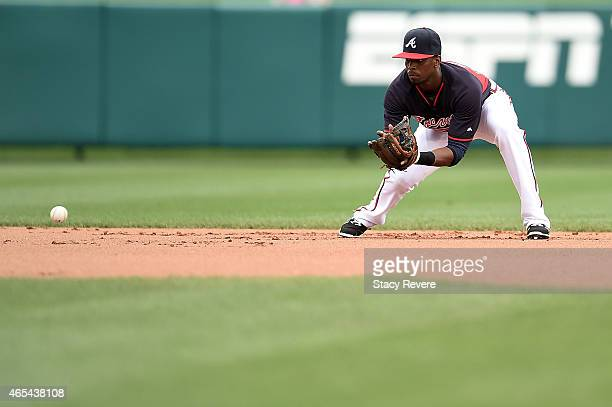 Pedro Ciriaco of the Atlanta Braves fields a ground ball during a spring training game against the Washington Nationals at Champion Stadium on March...