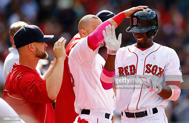 Pedro Ciriaco of the Boston Red Sox is congratulated by teammates in the dugout after hitting a solo home run in the eighth inning against the...