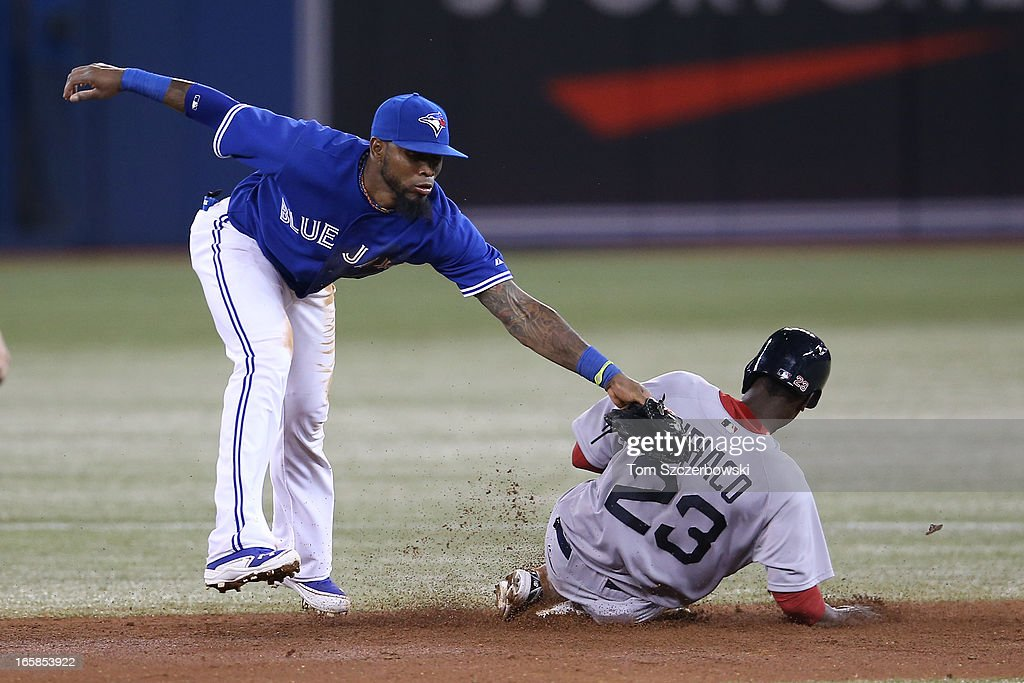 Pedro Ciriaco #23 of the Boston Red Sox steals second base in the third inning during MLB game action as Jose Reyes #7 of the Toronto Blue Jays cannot handle a throwing error by J.P. Arencibia #9 on April 6, 2013 at Rogers Centre in Toronto, Ontario, Canada.
