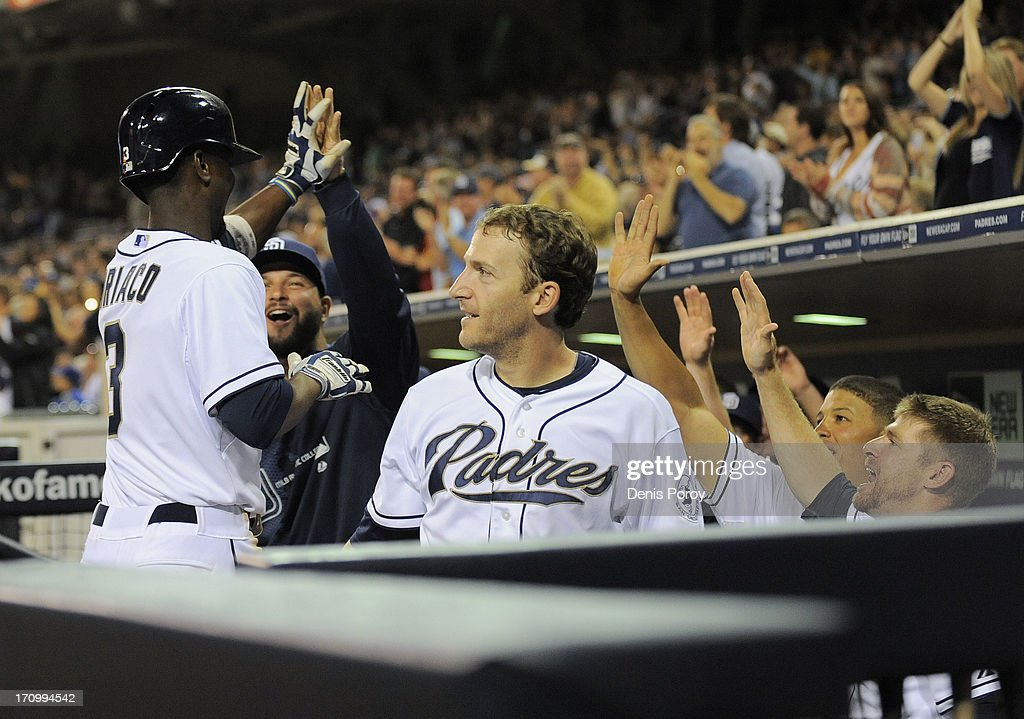 Pedro Ciriaco #3 of the San Diego Padres is congratulated by teammates after hitting a two-run homer during the eighth inning of a baseball game against the Los Angeles Dodgers at Petco Park on June 20, 2013 in San Diego, California. The Padres won 6-3.