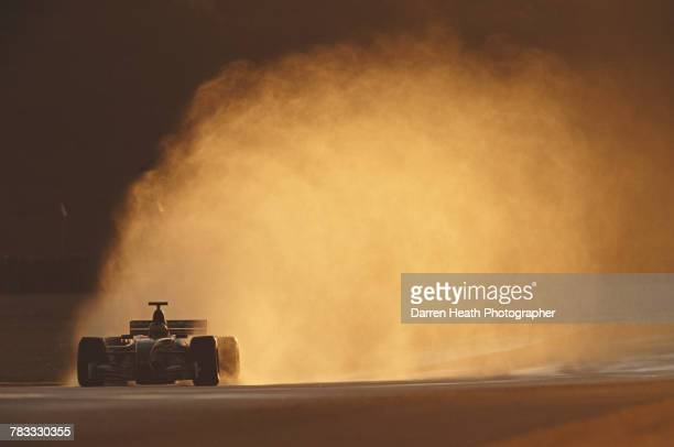 Pedro de la Rosa of Spain drives the Jaguar Racing F1 Team R3 Cosworth CR-3 in the wet during Formula One pre season testing on 10 January 2000 at...